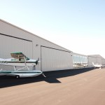 Cessna and Cirrus in Front of Offices - Exterior